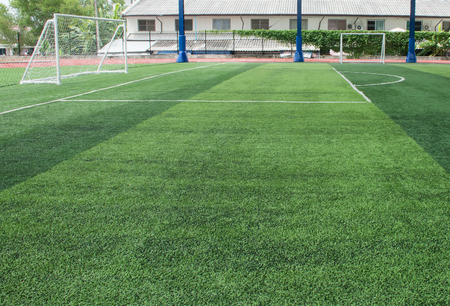 Soft focused picture of  Football field  or soccer field covered with artificial grass Stock Photo