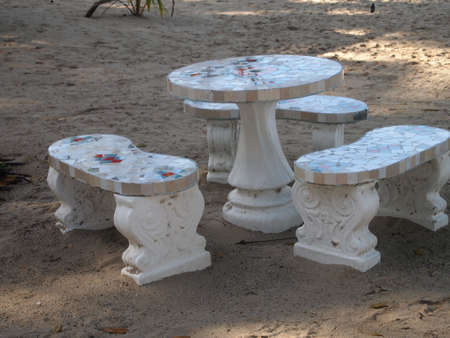 Stony benches and table on a beach photo