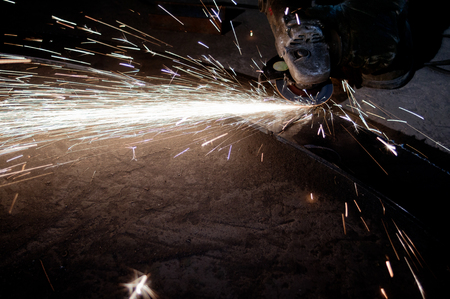 dazzling: Factory workers operating wheel of the dazzling spark