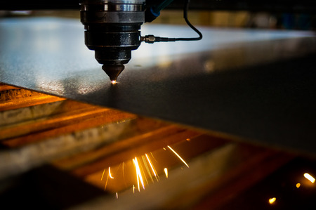 laser cutting: Laser cutting machined parts Stock Photo