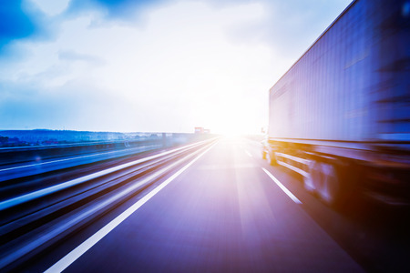 shipment: Container Trucking Stock Photo