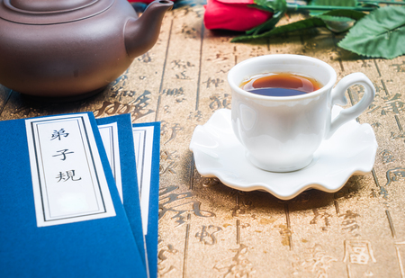 ancient book: Chinese tea, teapot and ancient book Stock Photo