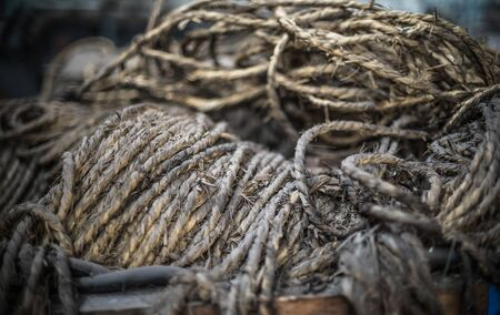 cordage: Ship ropes heap. Pile of various ropes and strings. Closeup of cordage. Background nautical texture