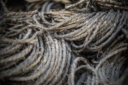 cordage: Ship ropes heap. Pile of various ropes and strings. Closeup of cordage.