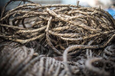 cordage: Ship ropes heap. Pile of various ropes and strings. Closeup of cordage.