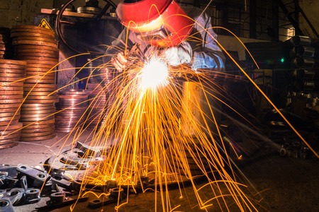 uses: sparks while welder uses torch to welding