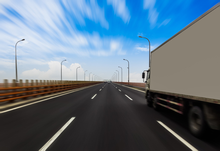 truck driver: Truck on a fast express road, motion blur