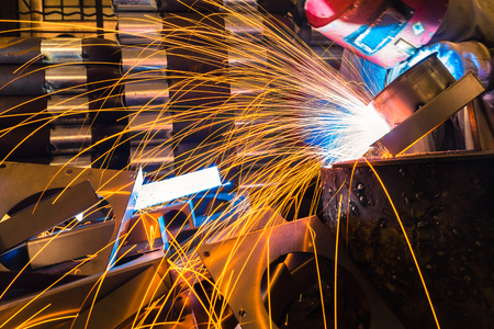 welding mask: sparks while welder uses torch to welding