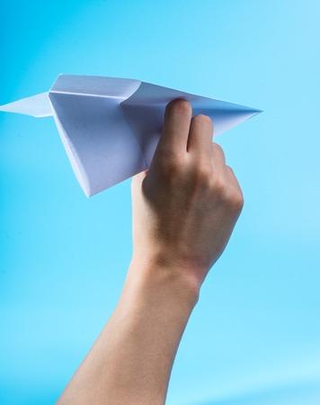Paper airplane and blue sky. Banco de Imagens