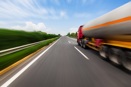 highway: Motion blurred tanker truck on the highway. Chemical industry and pollution concept.