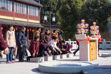 buddhism prayer belief: JIANGYIN, China in 2015 February 19: people burn incense at the first day of the Chinese new year to the temple to burn incense and pray, the year of the sheep, in February 19, began.
