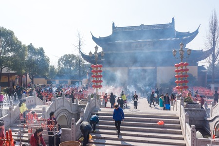 temple burn: JIANGYIN, China in 2015 February 19: people burn incense at the first day of the Chinese new year to the temple to burn incense and pray, the year of the sheep, in February 19, began.
