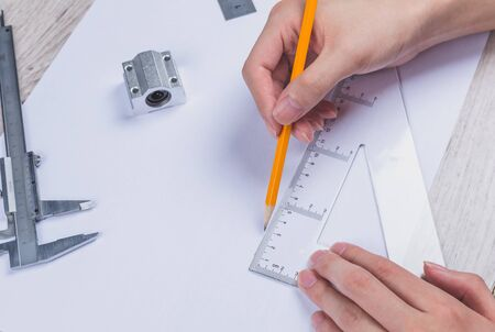 interior designer: Interior designer works on a hand drawing sketch using color pencils, rule and rubber