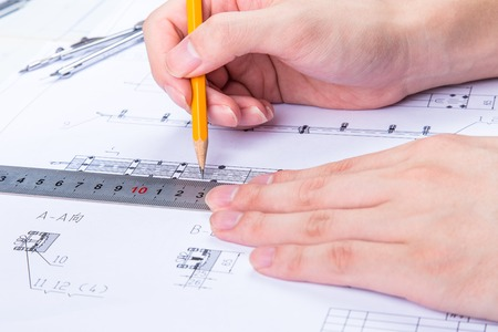 architectural design: Interior designer works on a hand drawing sketch using color pencils, rule and rubber