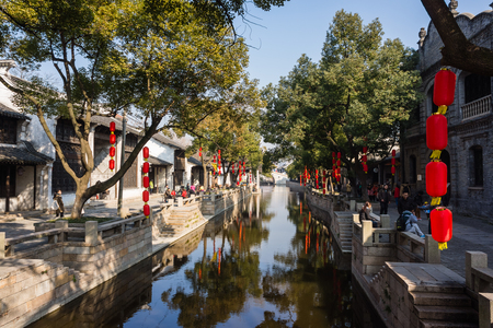 October 2, 2014, National Day holiday. Tourists from the ancient town of Xitang, Zhejiang Province, are sitting on a boat trip.