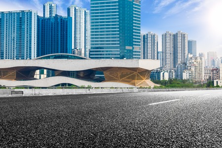 car on road: The city and the road in the modern office building background