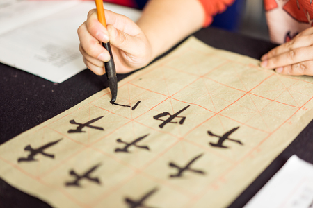 traditional culture: Chinese children learn to write Chinese characters, calligraphy is the traditional culture of China
