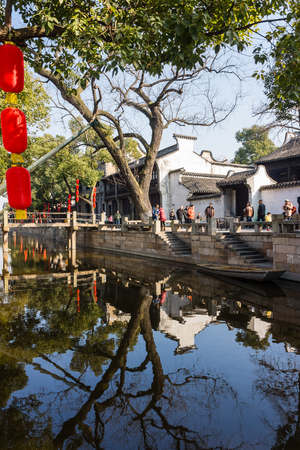 zhouzhuang: October 2, 2014, National Day holiday. Tourists from the ancient town of Xitang, Zhejiang Province, are sitting on a boat trip.