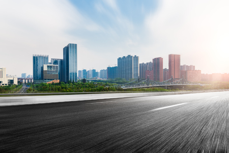 motion blur: The city and the road in the modern office building background