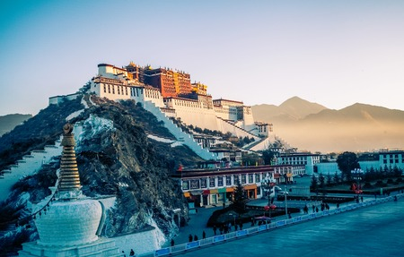 dalai: Potala Palace and stupa at dusk in Lhasa, Tibet Editorial