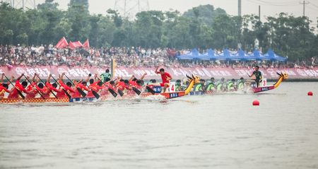 dragonboat: In June 11, 2013, a dragon boat race was underway in Jiangyin, Jiangsu Province, China. The dragon boat race is a traditional sport in China, which is generally held in the Chinese lunar calendar.
