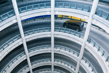 storey: Car driving in multi storey car park. Stock Photo