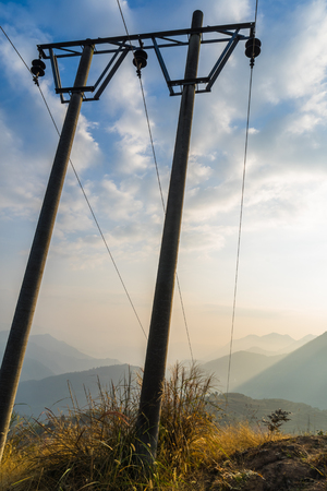 Low Angle View Of telegraph poles against blue sky. Stock Photo