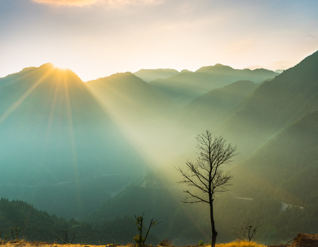 view of foggy mountain landscape at sunrise in China. Stock Photo