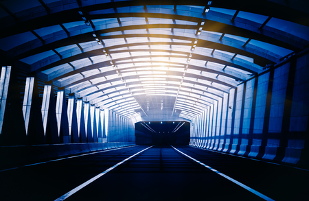 Traffic in a tunnel in blue tone.