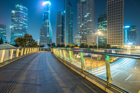 footbridge with cityscape at night in Shanghai,China. Stock Photo