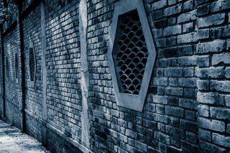 fanlight: traditional brick window in chinese garden.