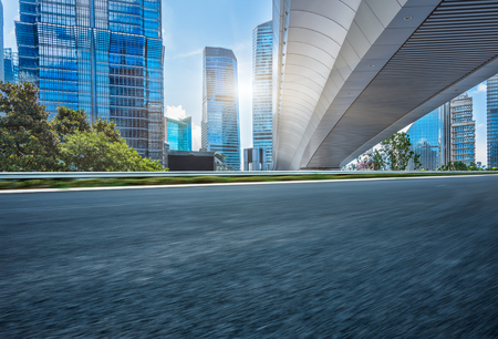 urban road: empty asphalt road with cityscape and skyline of Shanghai,China. Editorial