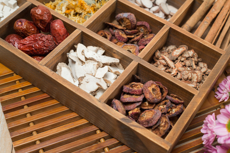 Chinese Herbal Medicine in box on table. Stock Photo