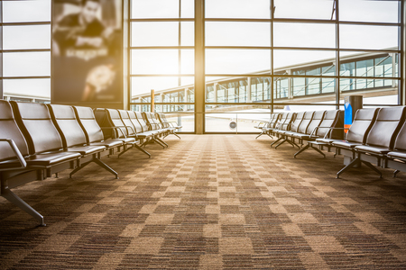 Rows of empty chairs at airport in China.