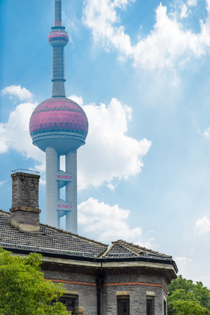 vintage house with part of oriental pearl tower in background,city skyline in China.