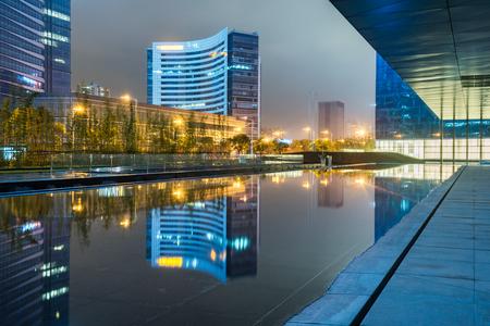 buildings standing by riverside under dramatic sky,Suzhou city,jiangsu province,China.
