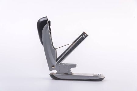 Close-Up Of Stapler On Table,against white background.