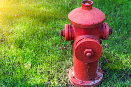 detail shot of fire hydrant on grass in city of China.