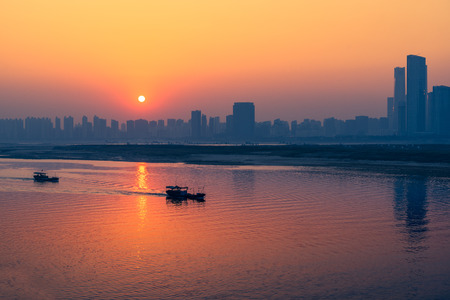 sunset view of cityscape along riverside,located in China. Stock Photo