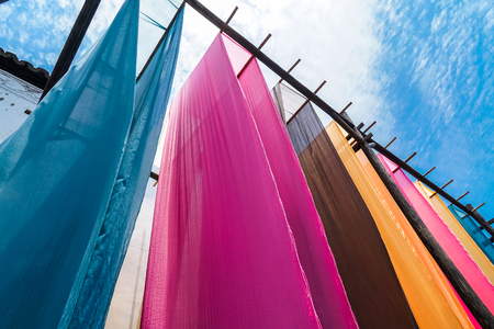 colorful fabric hanging to dry after traditional dye process,shot in Heng Dian Town,Zhejiang province of China.