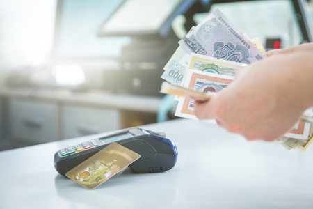 cash and card payment with chip and pin machine in shop. Stock Photo