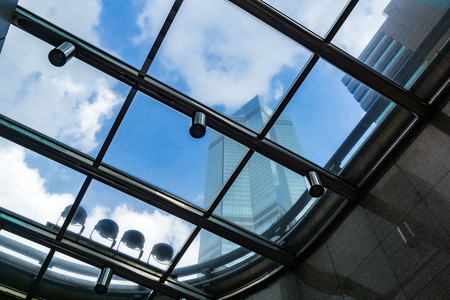 ceiling: Directly Below Shot Of glass Skylight in a modern building. Stock Photo