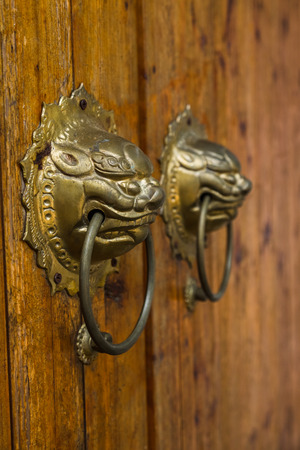 closeup of the antique oriental door knocker,Lishui city,china.