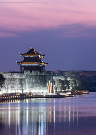 ancient Waterfront tower in city of China.
