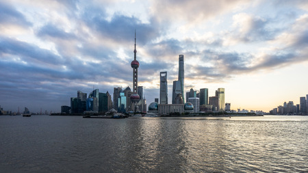 Shanghai skyline,landmarks of Shanghai with Huangpu river at sunrise/sunset in China.