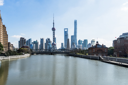 River And Modern Buildings Against Sky in Shanghai,China.