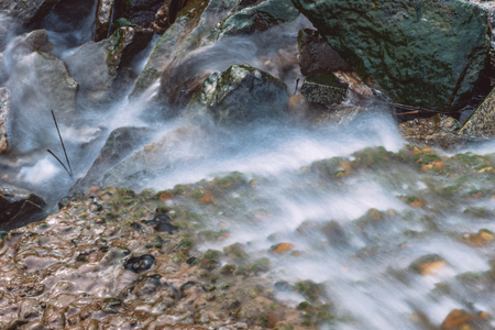Stream Flowing Through Rocks in forest.