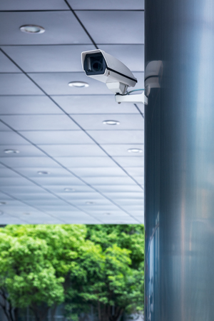 detail shot of CCTV security camera hanging on column