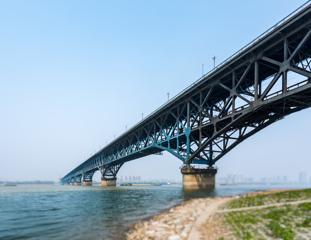 Long bridge across river in city of China. Banco de Imagens