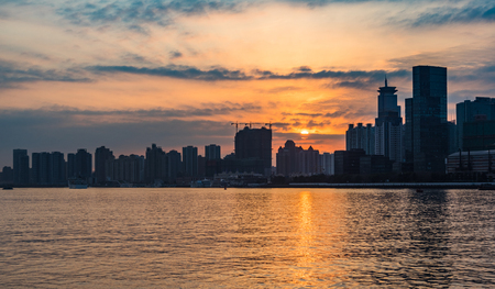 City Skyline By River  at twilight in city of China.